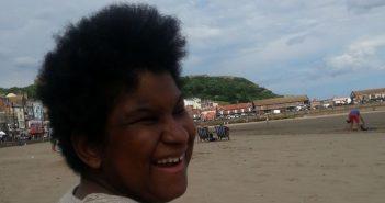 Tmara Senior, smiling, on a beach