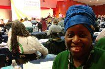 Jennifer Aggrey-Fynn smiling, in front of delegates at the conference