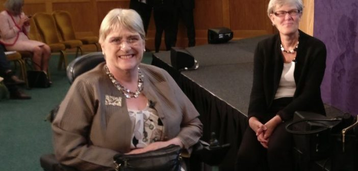 Baroness Brinton, smiling, with Kate Green sitting nearby