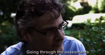 Head and shoulders of David Hooke, with subtitle saying 'Going through the assessments we've both got worse'