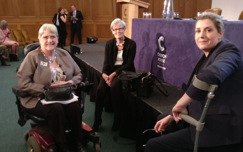Penny Mordaunt, Baroness Brinton and Kate Green sitting together in front of a stage