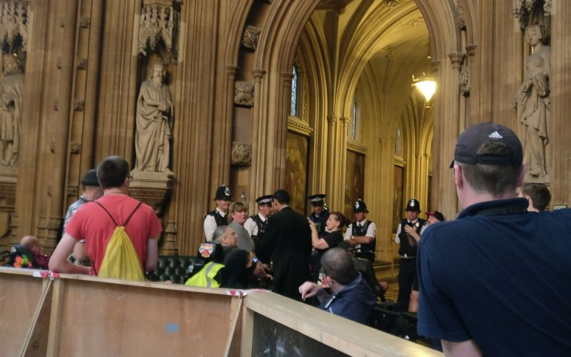 Police officers talking to activists in the House of Commons