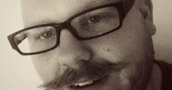 Ross Minton, moustache, glasses, head and shoulders