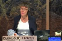 Theresia Degener sits, talking, behind a name plate saying T Degener