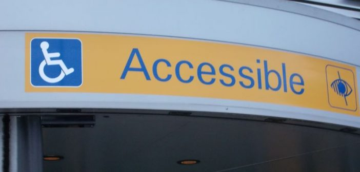 Disability logos and word 'accessible' above the entrance to an airport terminal