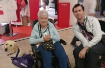 Anne Pridmore, her assistance dog, and Alex Hovden at the conference