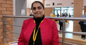 A woman in a pink jacket at the conference in Bournemouth