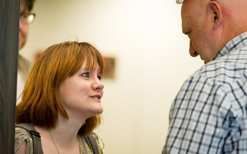 Ellen Clifford talking to a man