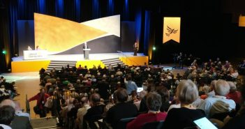 Liberal Democrats delegates watching a speaker on the stage at their annual conference