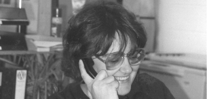 Black and white picture of Lorraine Gradwell on the phone