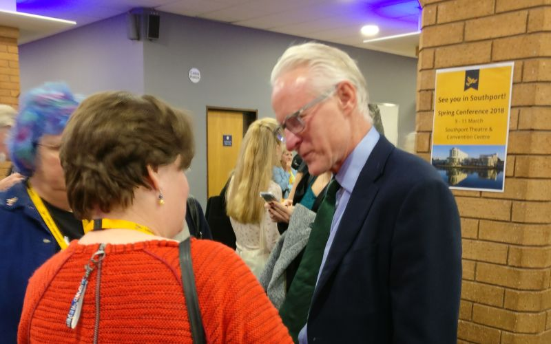 Norman Lamb talking to a woman at the conference