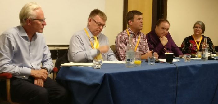 Paul Burstow on a panel with three other men and a woman