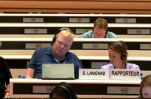 Stig Langvad sits with headphones on in UN debating chamber