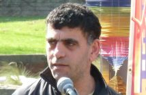 Kamil Ahmad speaks into a microphone