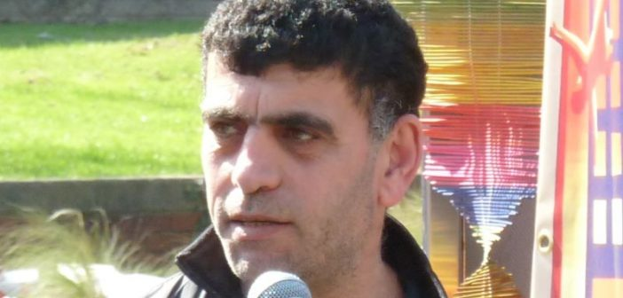 Kamil Ahmad speaking into a microphone