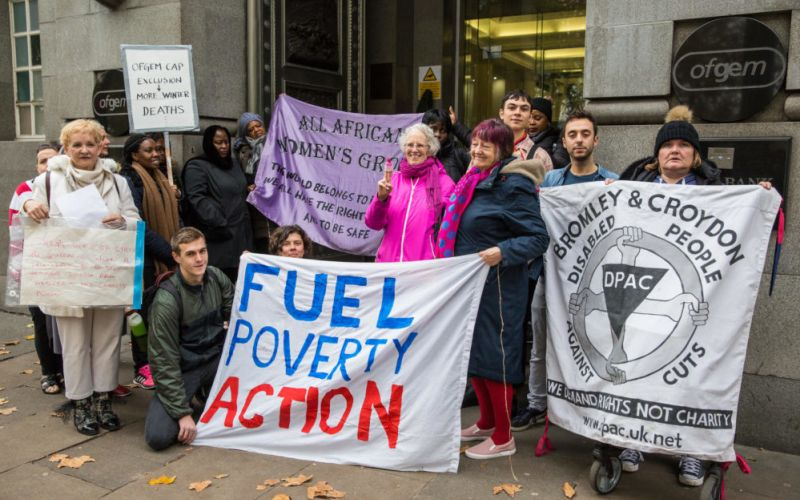 Campaigners outside Ofgem with banners