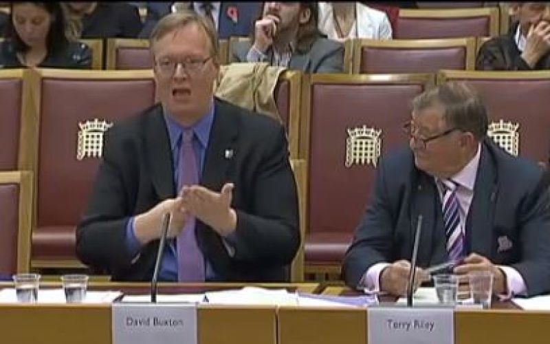 David Buxton, signing, and Terry Riley give evidence to a House of Lords committee