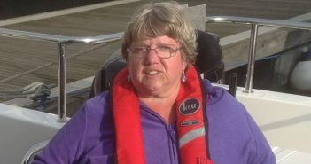 Anne Savidge in her wheelchair, with a lifejacket around her neck