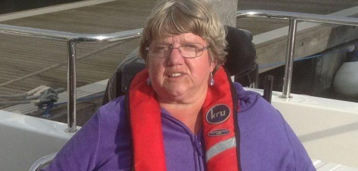 Anne Savidge in her wheelchair, with a lifejacket around her neck