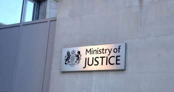 A Ministry of Justice sign on a grey wall