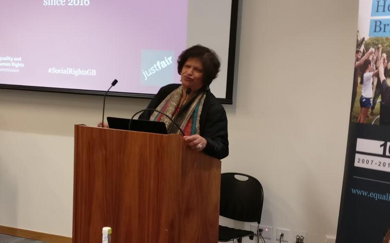 Virginia Bras Gomes speaking at a podium