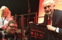 Nathan Lee Davies with Jeremy Corbyn who is holding a Save WILG tee shirt