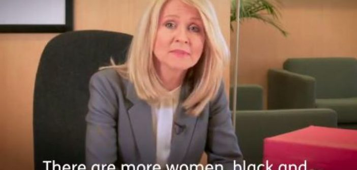 Esther McVey sitting at a desk, with subtitles showing the words: there are more women, black and minority ethnic and disabled people