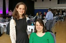 Natasha Hirst and Phoebe Kemp in front of a hall full of delegates