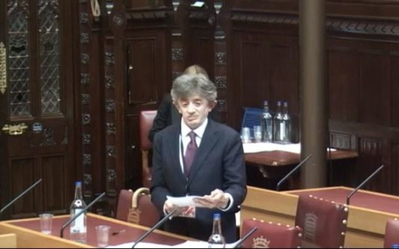 Lord Shinkwin speaking, from behind a table