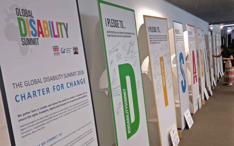 A large version of the Charter for Change resting against a wall