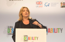 Penny Mordaunt speaking at a podium at the Global Disability Summit