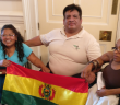 Feliza Ali Ramos and Alex Marcelo Vazquez Bracamonte hold a Bolivian flag with another disabled woman