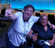 Simone Aspis holding her thumb up, next to Michelle Daley at the Civil Society Forum