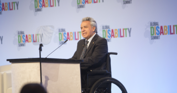 President Moreno speaking at a podium at the Global Disability Summit