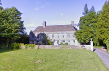 A beautiful manor house set back behind a low stone wall