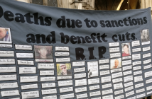 A banner showing the deaths of people due to sanctions and benefit cuts