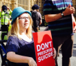 Juliet Marlow holding a placard saying Don't Prescribe Suicide