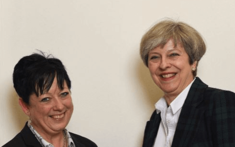 Jackie Doyle-Price shaking hands with Theresa May
