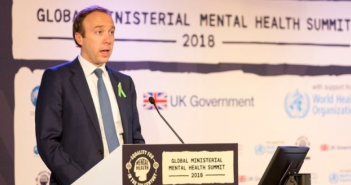 Matt Hancock speaking at a podium at the mental health summit