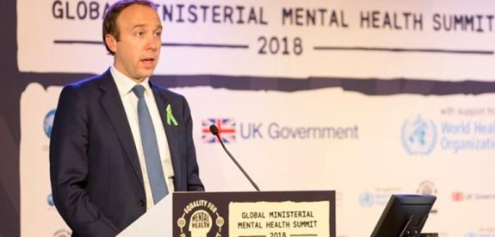 Matt Hancock speaking at a podium at the mental health summit