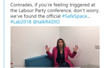 A woman sits on a couch and holds up her hands, beneath a tweet about the safe space