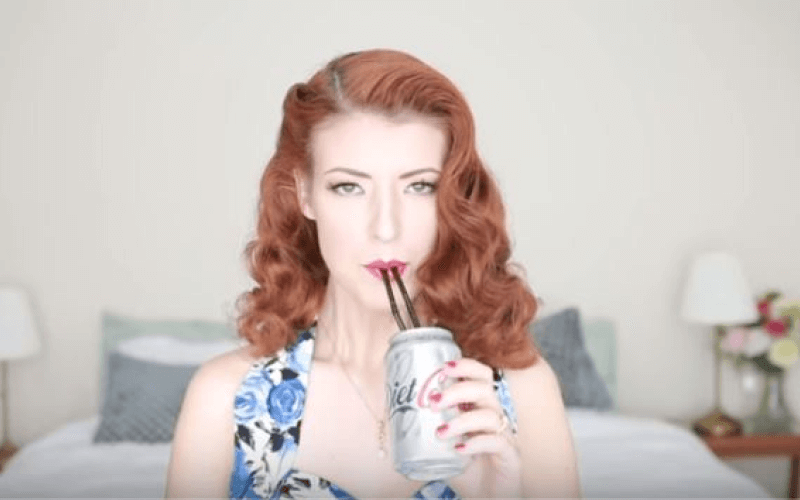 Jessica Kellgren-Fozard drinks from a can through two straws