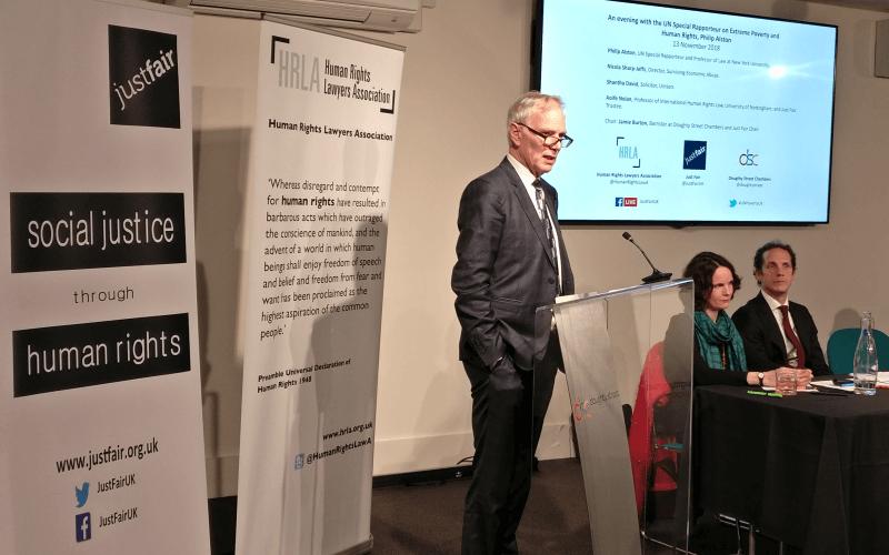Professor Alston speaking at a podium