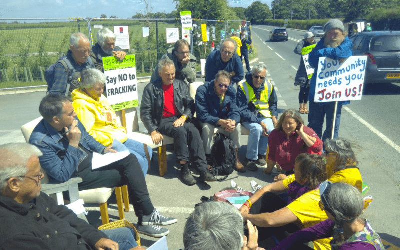 Jonathan Bartley sitting with protesters at Preston New Road