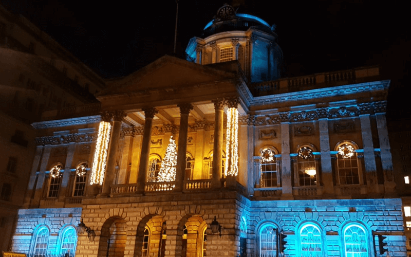 Liverpool Town Hall lit up in yellow and turquoise