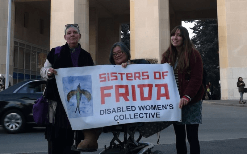 THree women holding a Sisters of Frida banner