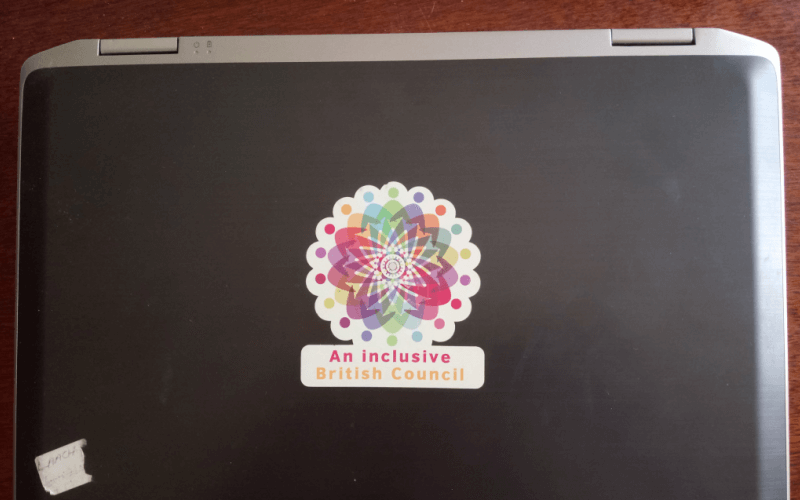 A laptop with a sticker saying an inclusive British Council