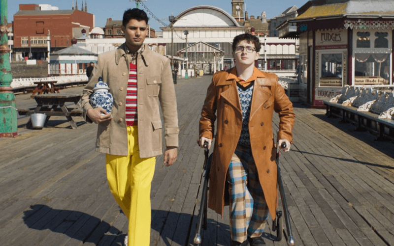 Jack Carroll and another actor walk towards the camera