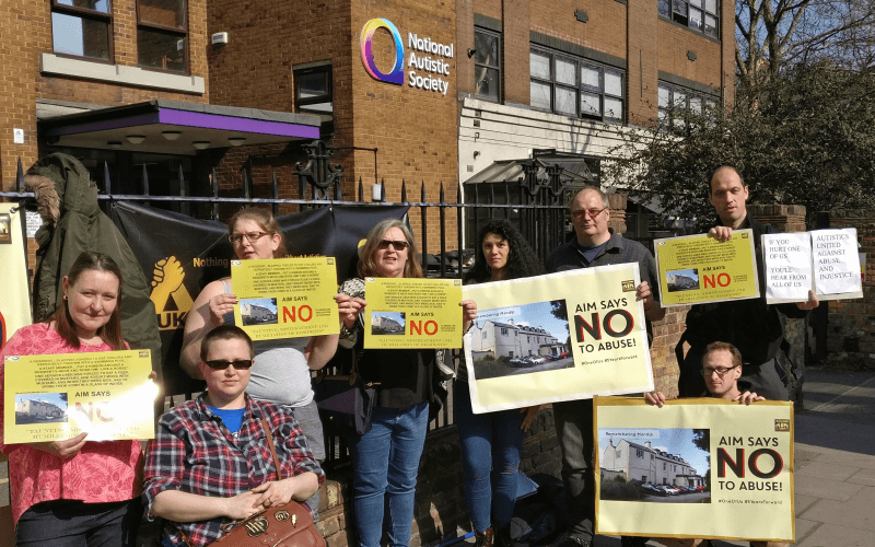 Protesters with placards outside the NAS offices