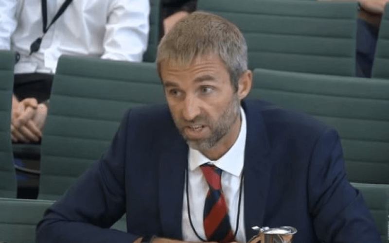 Matthew McClelland giving evidence in parliament